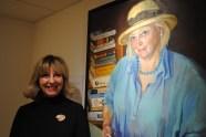 Sarah Richardson with her portrait of Caroline Dawnay