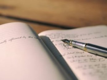 notebook with writing for blog