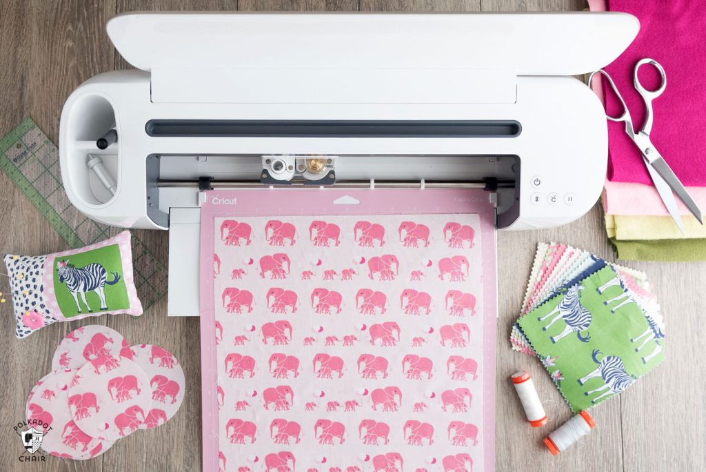top view of the cricut maker machine with different fabrics with animal patterns