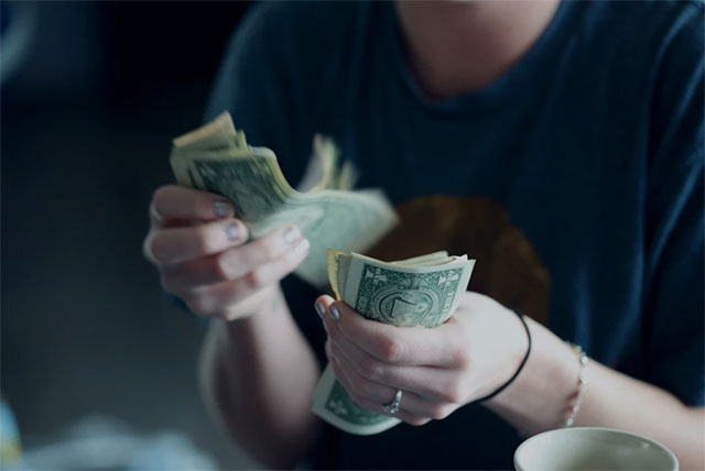 a person budgeting money
