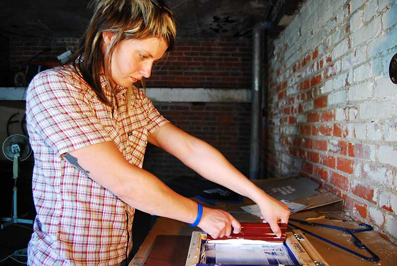 woman screen printing