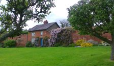 Wisteria and Clematis covered cottage