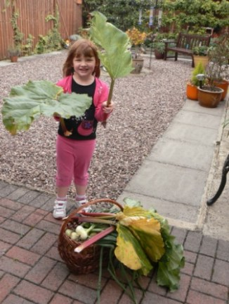 Rosie with her harvest of fresh fruit and veg
