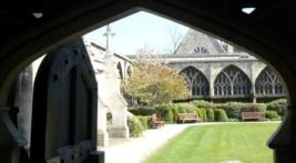 Open door at Gloucester cathedral from Cloisters to garden