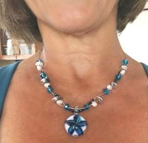 Floating bead necklace blue starfish pendant