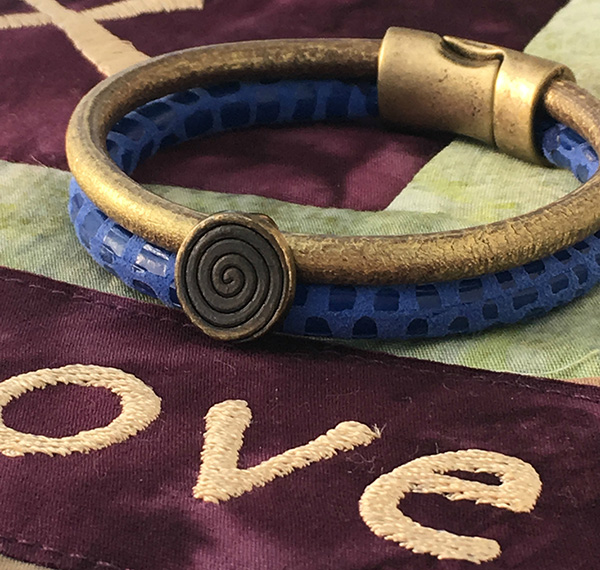 Leather bracelets blue gold brass