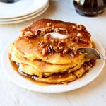 Butter Pecan Syrup and Cornbread Pancakes | Extraordinarily delicious from-scratch cornbread pancakes drizzled with homemade butter pecan syrup. A trip to food heaven! | heavenlyhomecooking.com