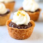 Nutella Tartlets | Nutella and semi-sweet chocolate filling in a shortbread crust, topped with orange whipped cream. Heavenly chocolate bites! | heavenlyhomecooking.com