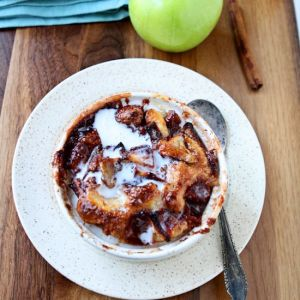 Magic Apple Cobbler | The batter goes in the bottom and magically rises to the top during the baking process. You will love this apple cobbler because the batter is placed in the bottom of the ramekin and topped with apples, cinnamon and sugar before baking resulting in a moist and flavorful cake! | heavenlyhomecooking.com