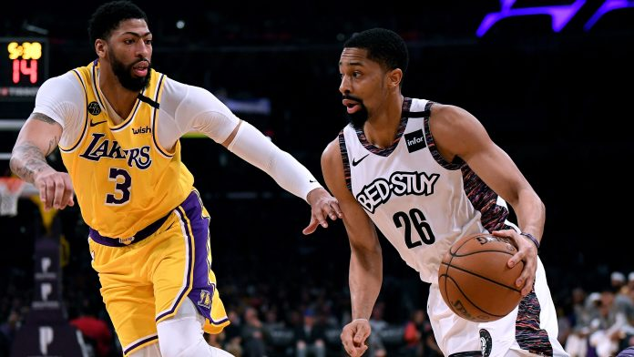 Spencer DInwiddie, right, of the Nets