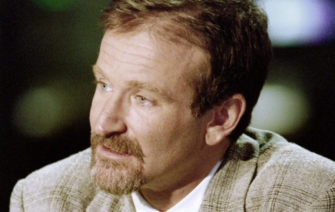January 31, 1994 in Boulogne-Billancourt, ouside Paris, shows US actor Robin Williams taking part in the broadcast news of French TV channel TF1.