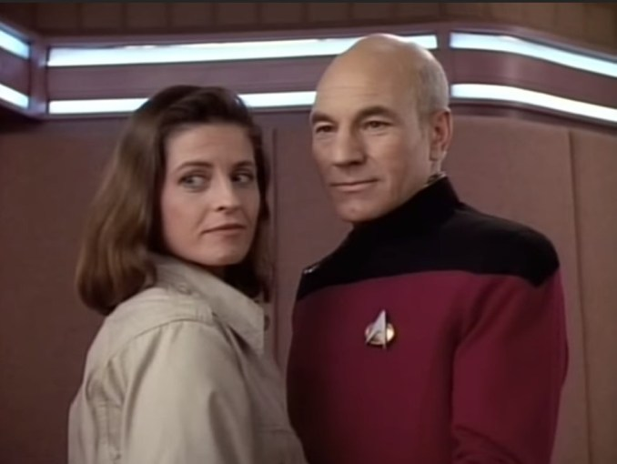 Jennifer Hetrick and Patrick Stewart as Vash and Captain Picard in
