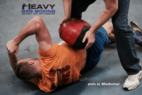 Jordan Shimmell takes a medicine ball to the ribs from trainer Dennis Shimmell