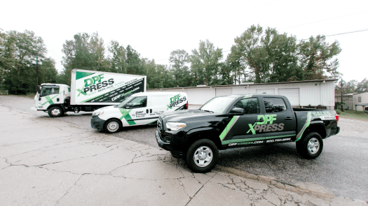 DPF Xpress trucks outside.