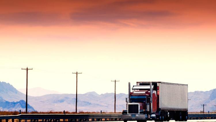 Semi Truck Driving red sky