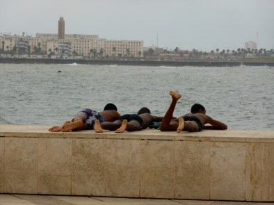 Youngster in the sea close to the Mosque Hassan II