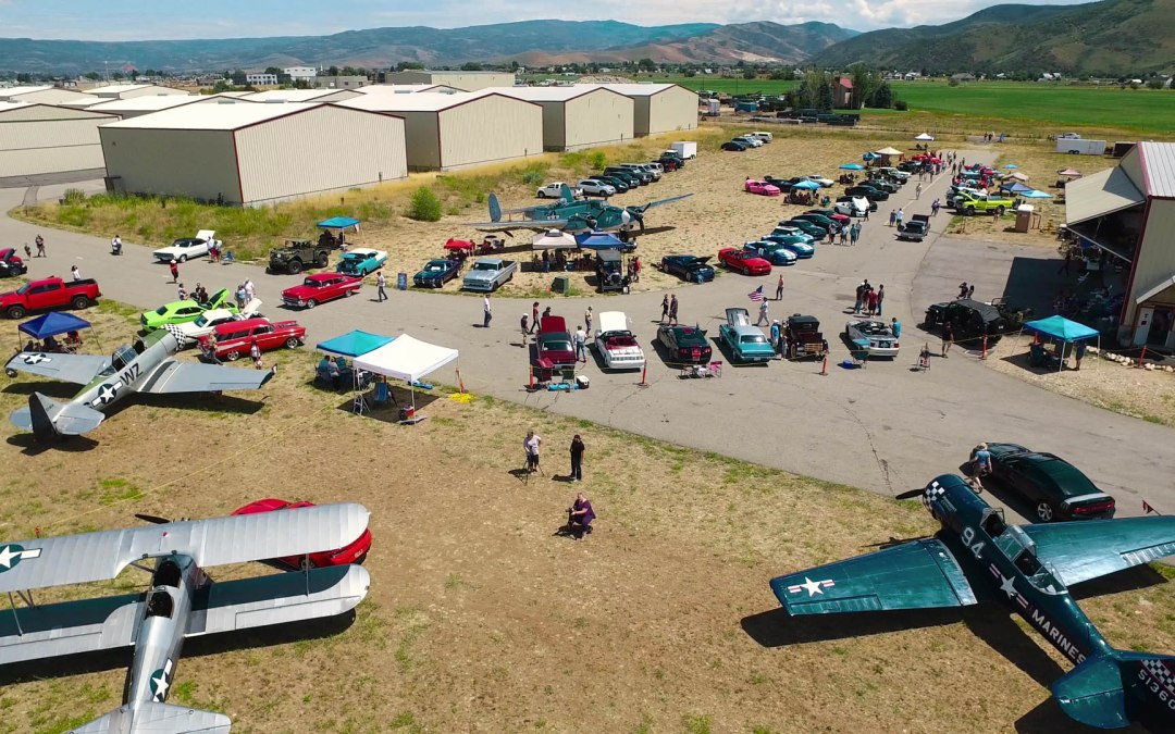 Aerial shot of vintage cars and airplanes at Heber Airport