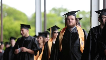 Graduates line up for their procession before the Berkshire Community College commencement ceremony at Tanglewood in Lenox, Mass. on Friday, May 30, 2014.