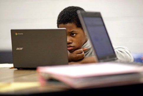 Haitian American Youth Financials Black Child on Acer Laptop