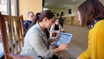 Wednesday, March 19: At Ridley HS, students sit in the hallways tapping out homework assignments on their cell phones to submit through cloud-based software. Here, in a hallway near the school's main office. seniors Libby Alfieri , left, and Kellie O'Brien, right, use their portable electronic devices i.e. iPad and iPhone as they complete school work between classes.