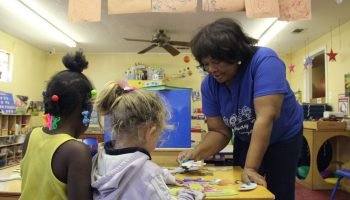 Children play with materials at Highway 90 Daycare in Pascagoula, Mississippi. Owner Sherrie Jones has relied on private help to make improvements to her center.