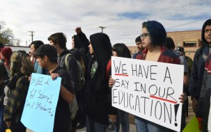 Dolores Ramos, 16, right, joins dozens of Highland High School students in Albuquerque, N.M., as students staged a walkout Monday March 2, 2015, to protest a new standardized test they say isn't an accurate measurement of their education. Students frustrated over the new exam walked out of schools across the state Monday in protest as the new exam was being given. The backlash came as millions of U.S. students start taking more rigorous exams aligned with Common Core standards.