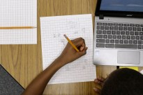 In this Feb. 12, 2015 photo, Yamarko Brown, age 12, works on math problems as part of a trial run of a new state assessment test at Annapolis Middle School in Annapolis, Md. The new test, which is scheduled to go into use March 2, 2015, is linked to the Common Core standards, which Maryland adopted in 2010 under the federal No Child Left Behind law, and serves as criteria for students in math and reading.