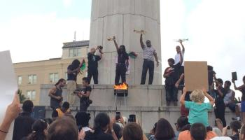 Burning of the Confederate flag - May 25 at Robert E. Lee Circle, New Orleans.