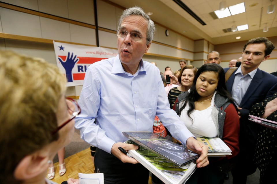 Former Florida Gov. Jeb Bush signs autographs following a town hall meeting, Saturday, May 16, 2015, at Loras College in Dubuque, Iowa.