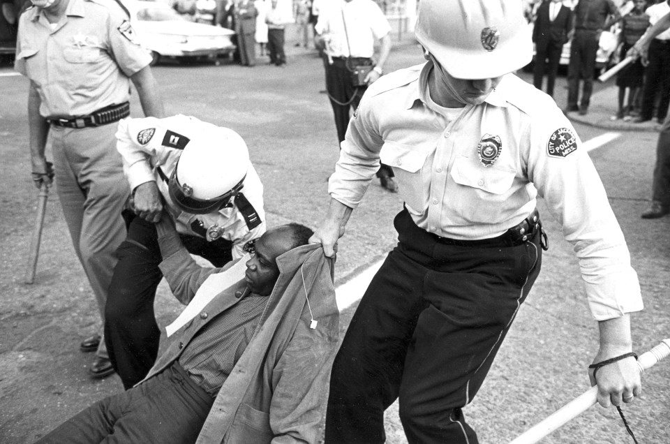Policemen are dragging away a protester during anti-segregation demonstrations in Jackson, Miss., on May 31, 1963. Several hundred members of the black community were arrested at a march protesting the beating of 26-year-old NAACP worker Willie Ludden by the police earlier that day.