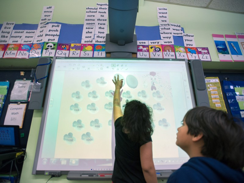 Pleasant View Elementary School first grader Rachael Rodriguez and Jeremy Gonzalez play a word game on an interactive screen during free time in her class this past May.