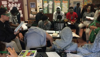 11th-graders at the Urban Assembly Gateway for Technology prepare for an experiment in chemistry class.