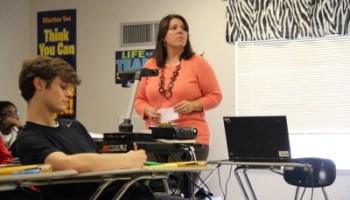 In this file photo, Tate County algebra teacher Molly Berry teaches parabolas to her class. Berry said that consistent leadership and high expectations helped the district improve under state control.