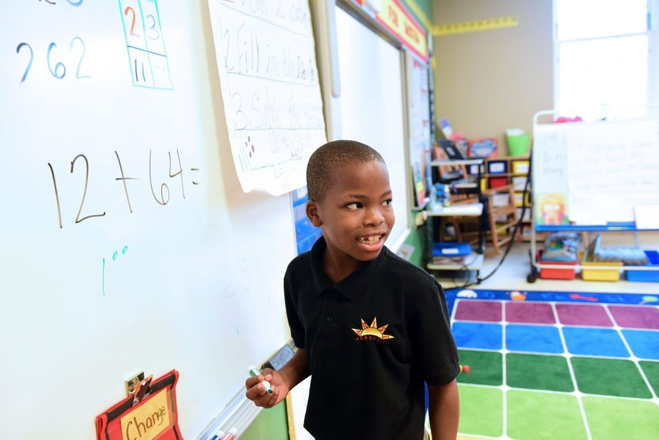 A second-grader at Arise Academy completes a math problem. A new, harder test to measure student proficiency has made it more difficult for the school to reach its improvement goals.