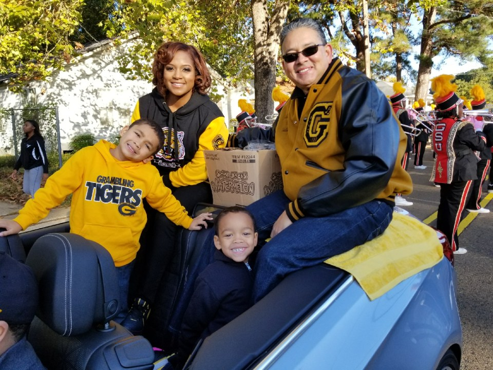 Grambling State University President Richard Gallot, Jr. (pictured right) rides in the homecoming parade in Grambling, LA with his family. A recent study from the United Negro College fund reported that HBCUs like Grambling have a combined annual economic impact of nearly $15 billion.