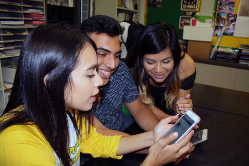 Adriana Villegas, 17, discovers something new in Strides as Robert Vaca, 17, and Angelica Duque, 17, look on. All three students are seniors at Roosevelt High School in Fresno.