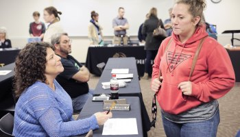 Andrea Laminack, a female welder, talks to Nikki Bond, a prospective student, at an open house at West Georgia Technical College for women interested in vocational trades.