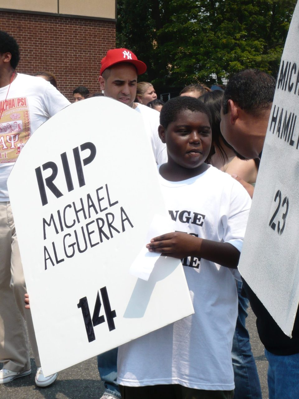Young people protesting gang violence in Long Island after the death of a 15-year-old outside Hempstead High School.