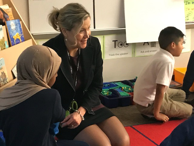 McMicken Heights Elementary School principal Alexandria Haas sits with second-graders during a morning activity developed by the Yale Center for Emotional Intelligence. Students take 20 minutes each day to work on social interactions and understanding their emotions.