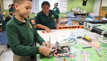 Fifth-grader Camar Graves adjusts his Lego robot in a robotics class at Elm City College Prep, in New Haven, Connecticut.