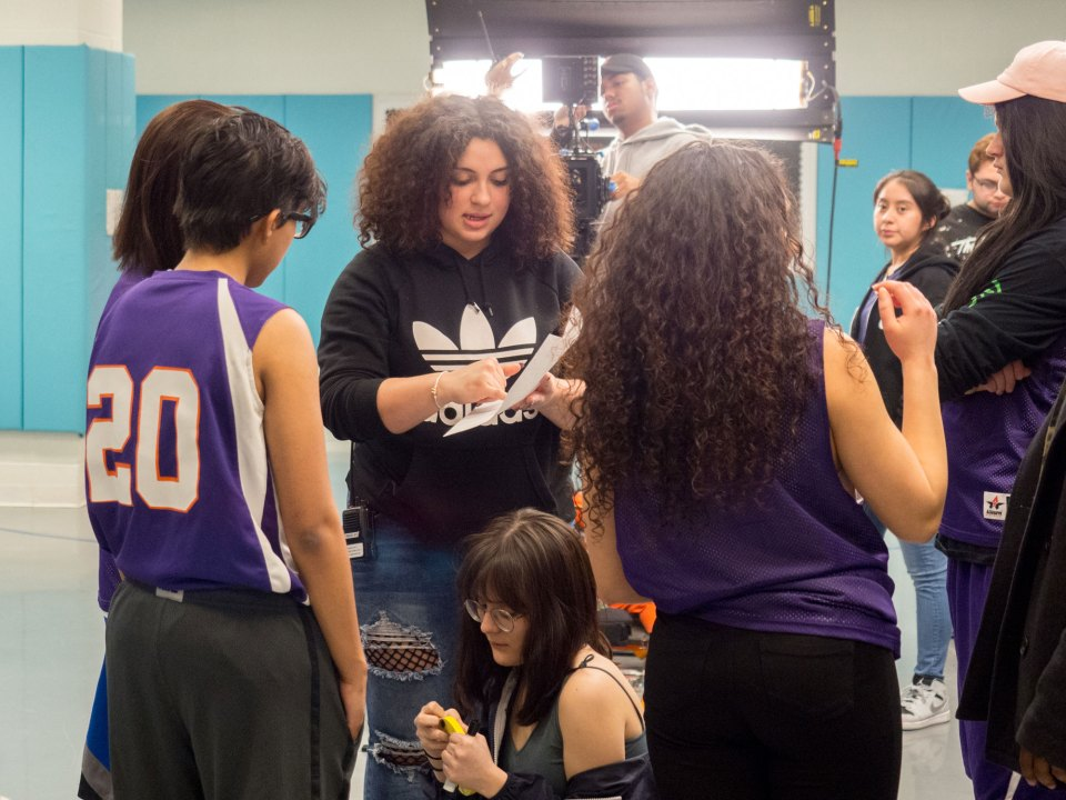 Aniya Vega, 17, works with actors during a shoot for her senior honors project at the Academy for Careers in Television and Film high school in Queens, New York.