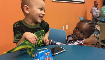 Dominic, 3 and Zaire, 2, play while their moms take part in a conversation about bullying at a Family Scholar House Café Night.