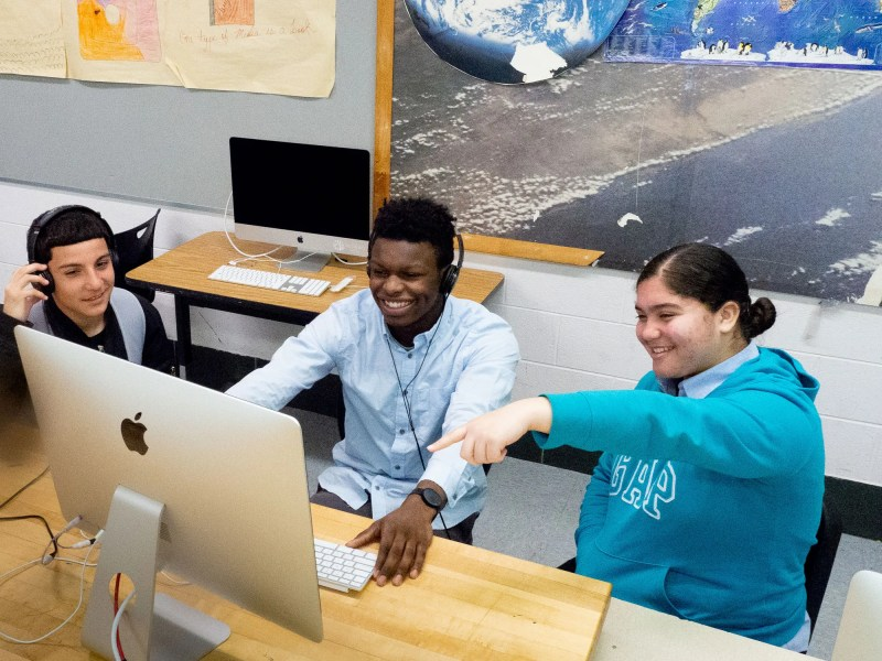At The LINC High School, students Jose Vasquez, Sevonne Brockington and Anjeline Genao review a video project in the school's digital lab.