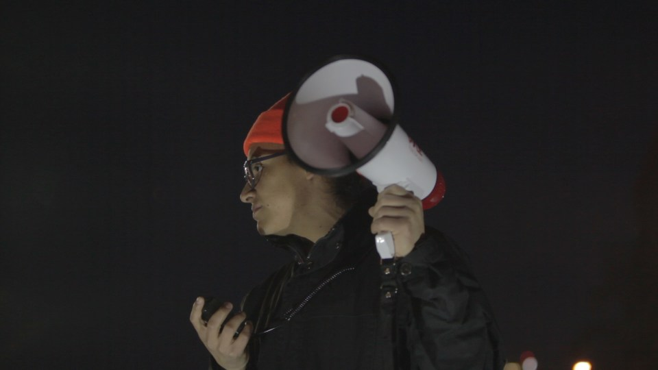 Victor Perez speaks during a protest in downtown Kansas City, MO.
