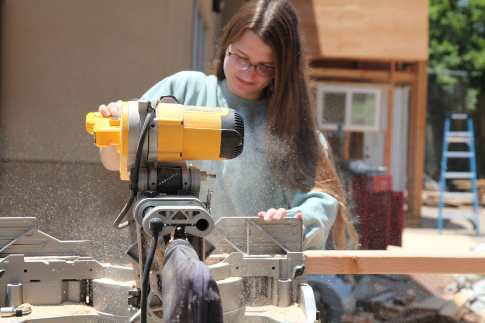 Caitlin Pierce, 17, uses a power saw during a construction class at Abraxas Continuation High School, in Poway, California.