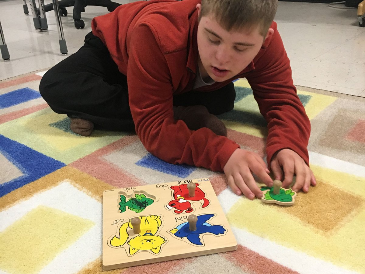 Brady Lafleur completes a puzzle in a specialized classroom at the old McDonogh 35 Senior High School facility.