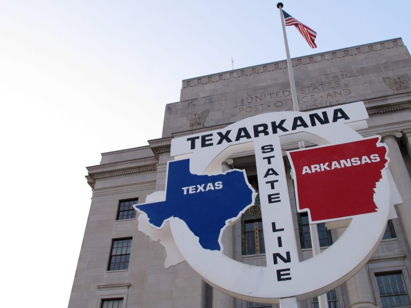 The line between Texas and Arkansas in front of the bi-state federal building, which straddles both. Texas A&M University at Texarkana has one of the lowest retention rates of public higher-education institutions; 55 percent who started in 2012 were gone by 2016.