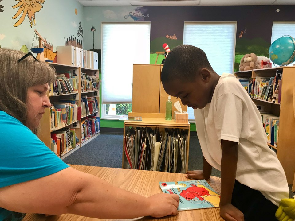 Teacher Robin Clemens helps Niccali McMullen, 5, sound out a word at Martin Luther King Montessori School in Fort Wayne, Indiana.