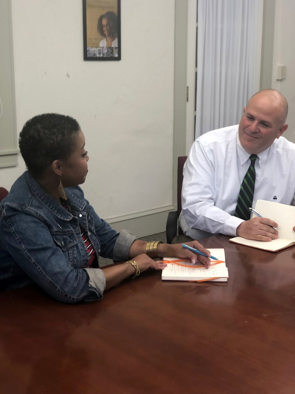 Rachel Edens, an assistant dean, chats with Dartmouth's financial aid director G. Dino Koff.