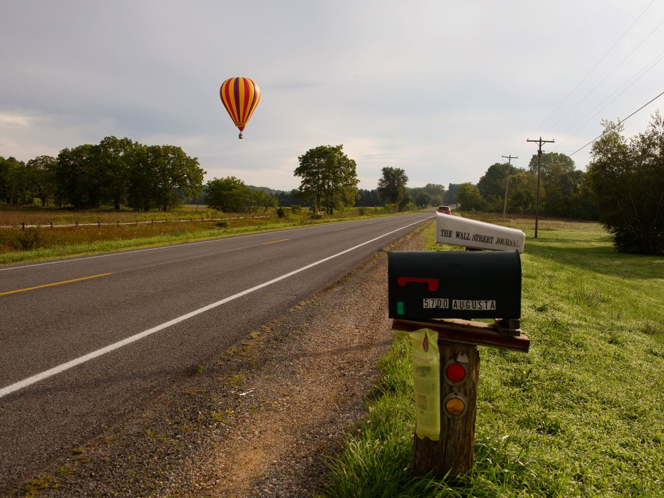 A hot air balloon prepares to land in rural Michigan near Battle Creek. New research shows that colleges seldom recruit from high schools in sparsely populated rural areas.